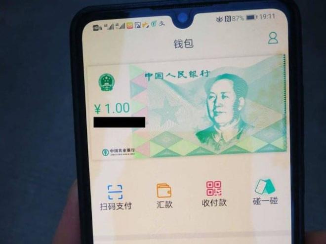Trung Quốc thử nghiệm công khai tiền điện tử, phát miễn phí 30 USD cho mỗi người dân - Ảnh 2.