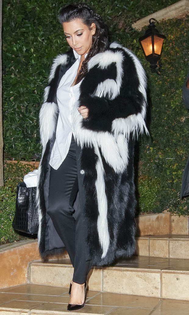 Kim Kardashian wearing a huge fur coat