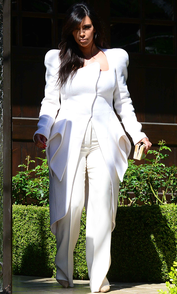 Kim Kardashian wearing a white suit