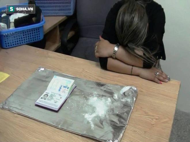 Nữ du khách mang gần 2 kg ma túy qua Sân bay Tân Sơn Nhất - Ảnh 1.