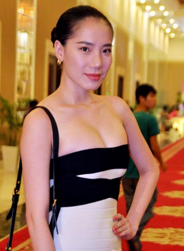 Vẻ nóng bỏng của người đẹp Việt Nam giữ kỉ lục đi thi quốc tế - Ảnh 6.