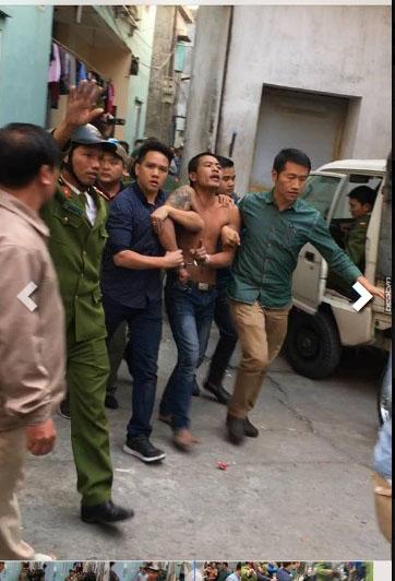 Nam thanh niên đập phá nghĩa trang rồi chém trọng thương công an ở Hà Nội - Ảnh 2.