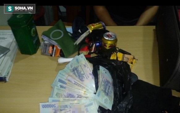 Hành khách Trung Quốc lấy trộm 400 triệu đồng trên chuyến bay đến Đà Nẵng - Ảnh 1.