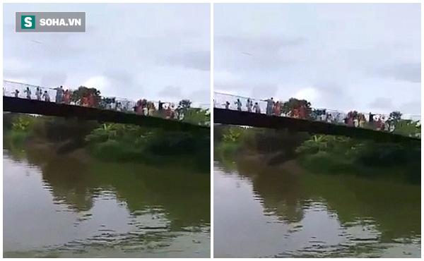 Cầu treo đứt dây, 29 người ngã thẳng xuống sông - Ảnh 2.