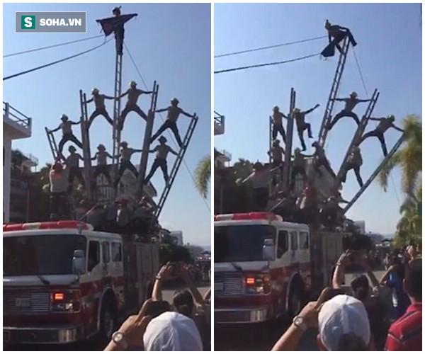 Clip: Gặp lỗi khi trình diễn, nhóm lính cứu hỏa bị ngã gãy xương - Ảnh 2.