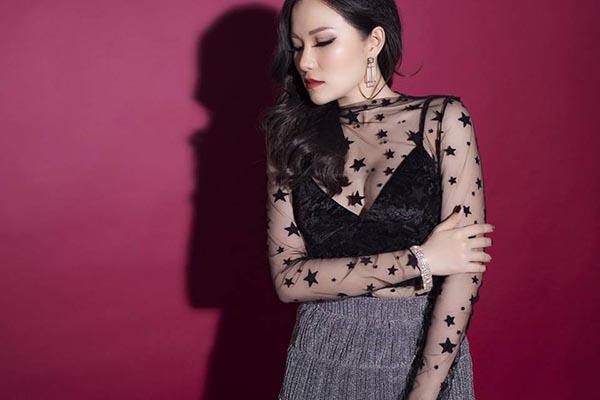 Loạt hình lột xác gợi cảm của vợ cũ Lâm Vinh Hải - Ảnh 2.