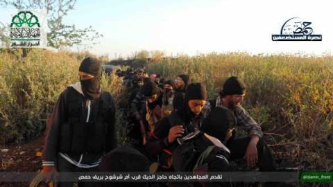 Các chiến binh thánh chiến hoảng sợ quay súng giúp Quân đội Assad - Ảnh 1.