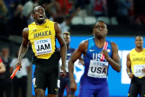 Usain Bolt chấn thương, lê lết về đích ở lần chạy cuối cùng trong sự nghiệp - Ảnh 1.