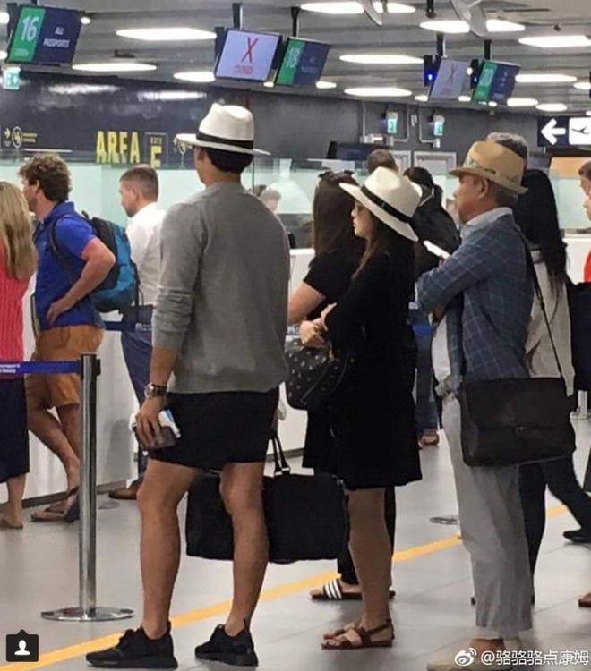 Kim Tae Hee lấy túi che bụng bầu khi đi cùng ông xã Bi Rain - Ảnh 2.