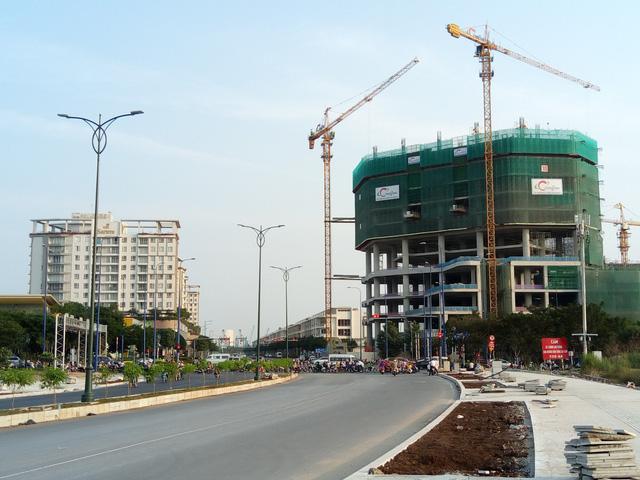 Cận cảnh đại công trường bán đảo Thủ Thiêm sau 4 năm ồ ạt xây dựng - Ảnh 5.