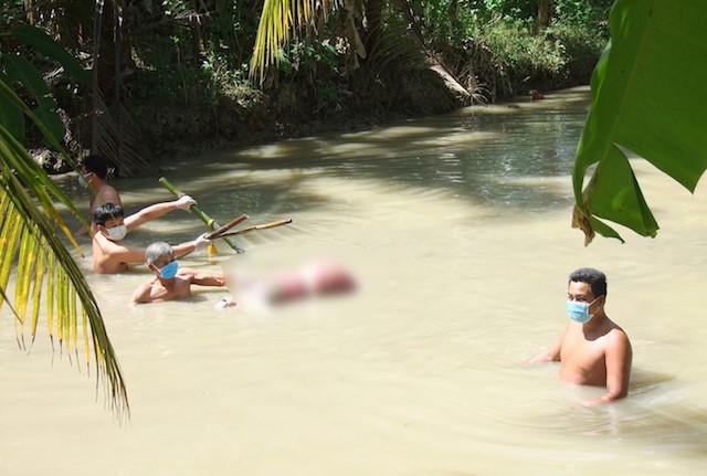 Bất ngờ về thủ phạm vụ người phụ nữ 2 chân bị trói, tử vong dưới ao nước ở Trà Vinh - Ảnh 1.