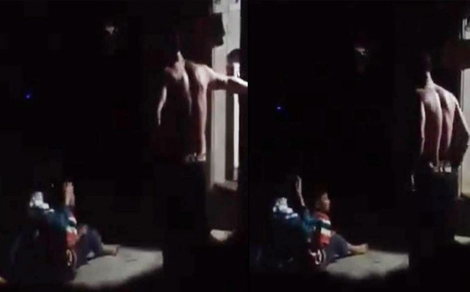 Xôn xao đoạn clip nghi bố bạo hành con trong đêm ở Hà Nội - Ảnh 1.