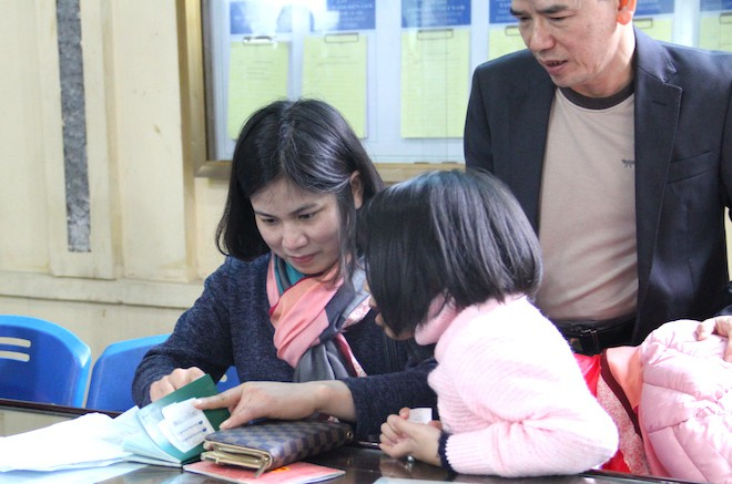 Sau Tết, hàng nghìn người dân Nghệ An đổ xô đi làm giấy thông hành để xuất ngoại - Ảnh 15.