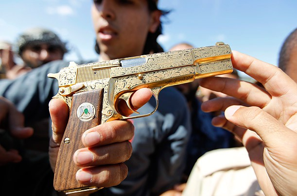 Từ cung điện tới cống ngầm: Đằng sau hành trình cuối cùng của cố lãnh đạo Libya Gaddafi - Ảnh 2.