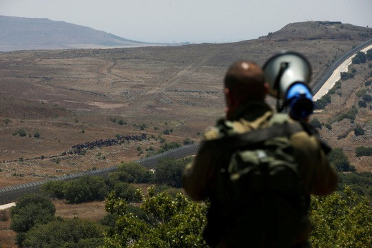 Israel khuyến cáo thường dân Syria tránh xa biên giới - Ảnh 1.