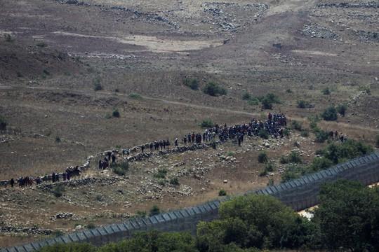 Israel khuyến cáo thường dân Syria tránh xa biên giới - Ảnh 3.