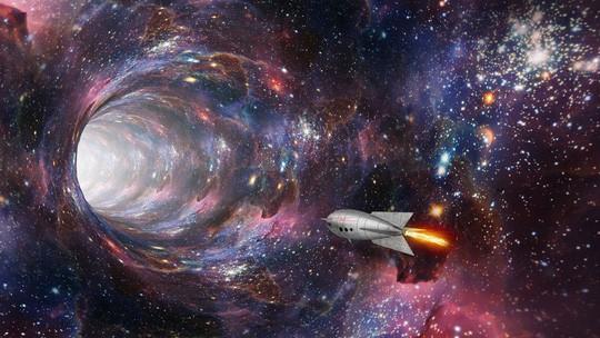 Lỗ đen quái vật là cổng vào thế giới khác? - Ảnh 1.