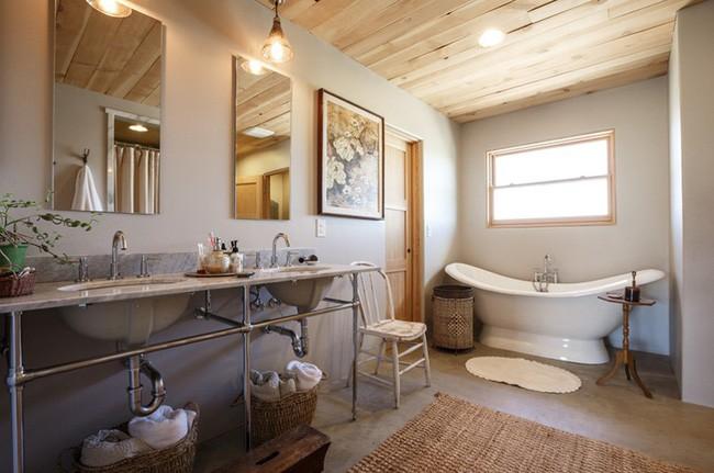 19. Không gian thư giãn được chọn lựa chất liệu cói tự nhiên làm thảm và giỏ đựng đồ cũng là cách làm mới cho căn phòng.