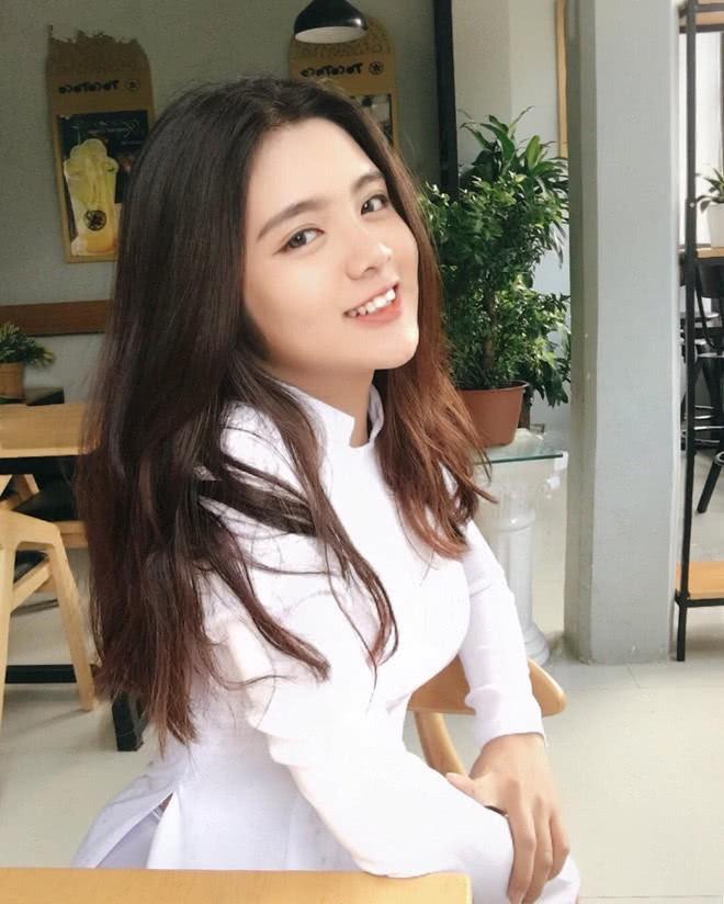 Báo Trung phát sốt về một nữ sinh Việt mặc áo dài, khen ngợi nhan sắc xinh đẹp đủ tầm tham gia showbiz - Ảnh 7.
