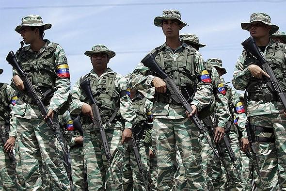 [ẢNH] Đấu súng dữ dội dọc biên giới Venezuela - Colombia - Ảnh 10.