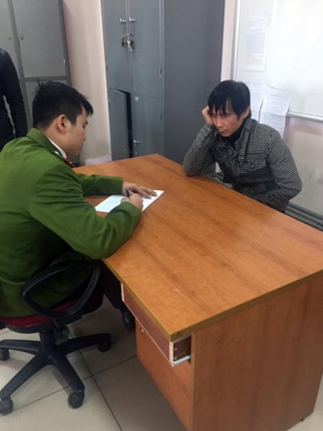 Đối tượng Nguyễn Quang Vinh tại cơ quan điều tra.