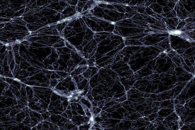 Lát cắt hình ảnh mô phỏng cho thấy vật chất tồn tại ở dạng mạng sợi tơ trong vũ trụ. Các dải ngân hà nằm trong các đốm trắng sáng và dày đặc.