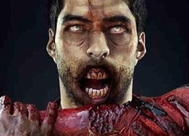 """Biếm họa """"kẻ ăn thịt người"""" Luis Suarez"""