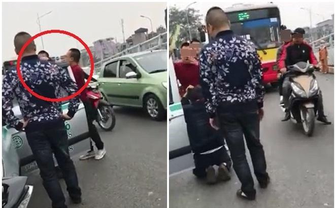 Tài xế taxi bị đánh, phải quỳ xuống xin tha giữa đường phố Hà Nội