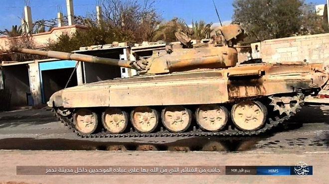 Mỹ mỉa mai vũ khí Nga bỏ lại Palmyra - Ảnh 9.