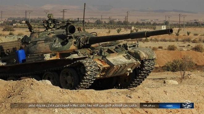 Mỹ mỉa mai vũ khí Nga bỏ lại Palmyra - Ảnh 10.