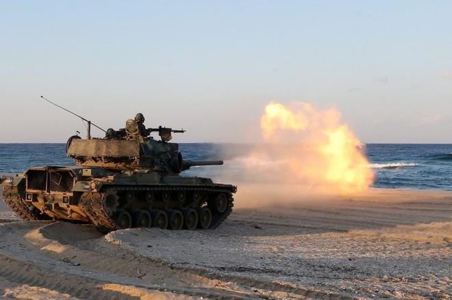 24h qua ảnh: Xe tăng Hàn Quốc nã pháo xuống biển - Ảnh 5.