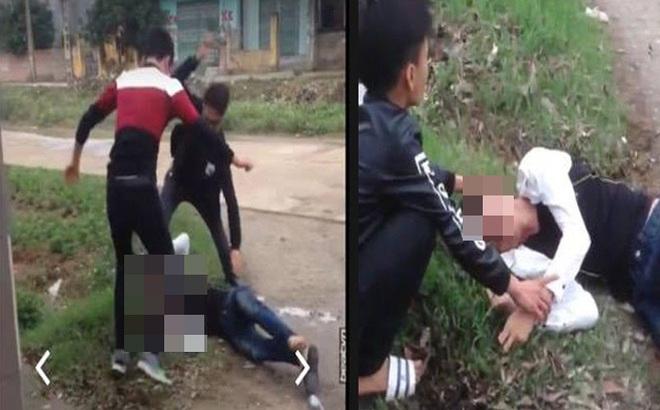 Nam thanh niên cầm dao bị nhóm mang tuýp sắt đánh gục ở cổng trường