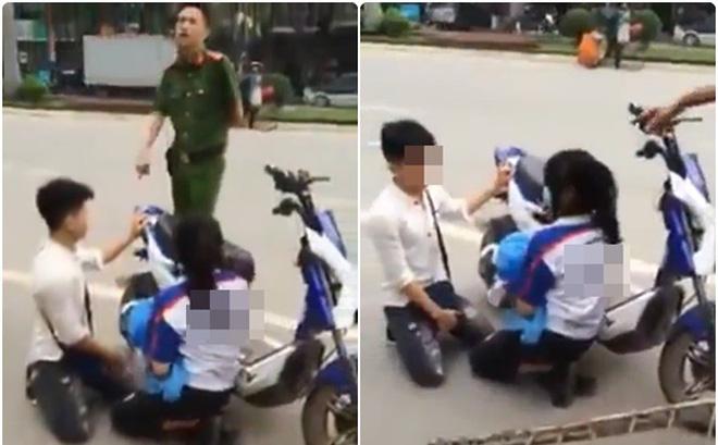 Thanh niên quỳ gối giữa đường xin Công an thả xe cho người yêu