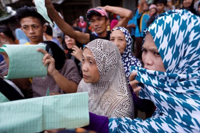 Hình ảnh cuộc sống khó khăn của người dân Marawi trong trại tị nạn - Ảnh 3.
