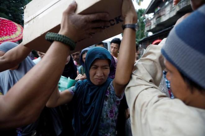 Hình ảnh cuộc sống khó khăn của người dân Marawi trong trại tị nạn - Ảnh 4.