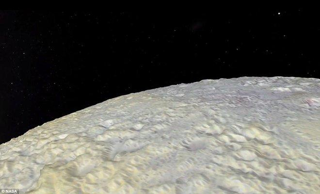 NASA lần đầu công bố bề mặt dị thường của hành tinh xa nhất trong Hệ Mặt trời - Ảnh 4.