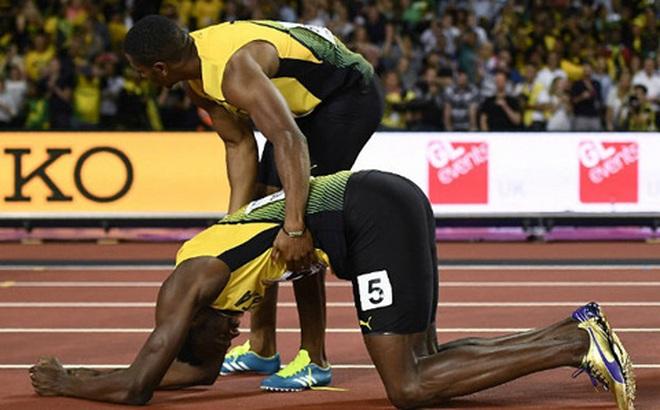 Usain Bolt chấn thương, lê lết về đích ở lần chạy cuối cùng trong sự nghiệp