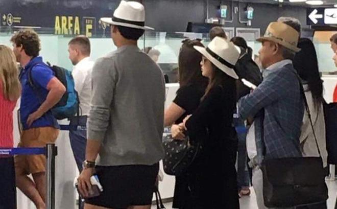 Kim Tae Hee lấy túi che bụng bầu khi đi cùng ông xã Bi Rain