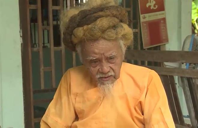Lạ lùng mái tóc cụ ông hơn 70 năm chưa cắt - Ảnh 2.