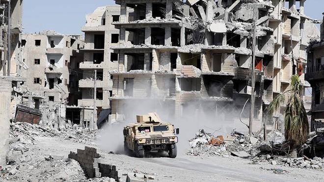 Rút quân khỏi Syria: TT Putin tuyên bố chiến thắng và đuổi khéo người Mỹ - Ảnh 1.