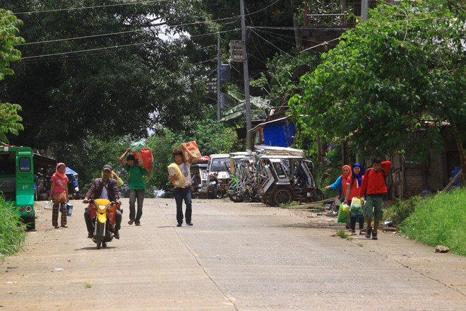 Những hình ảnh đầu tiên từ thành phố ma Marawi, nơi bị IS chiếm đóng ở Philippines - Ảnh 5.
