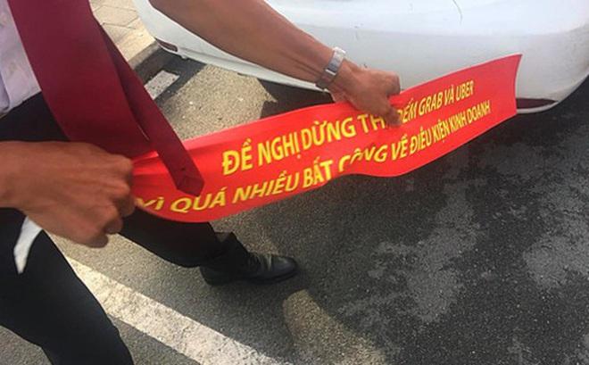 Hiệp hội Vận tải Hà Nội khuyên hãng taxi kiềm chế trước Uber, Grab