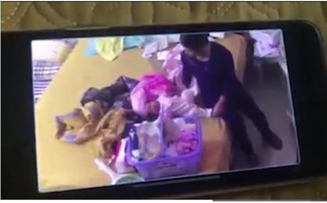 Image result for người giúp việc bạo hành trẻ sơ sinh