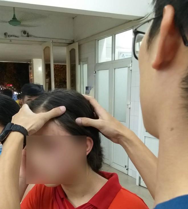 Hà Nội: Nữ sinh lớp 9 tố bị mẹ kế đánh nhập viện chỉ vì chậu quần áo - Ảnh 1.