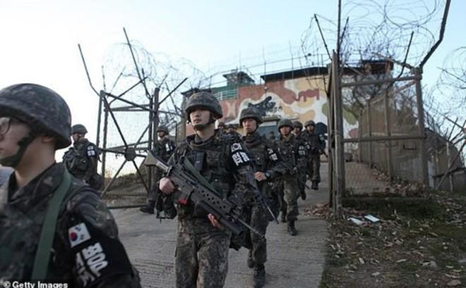 Binh sỹ Triều Tiên và Hàn Quốc rời khỏi 20 trạm gác dọc giới tuyến