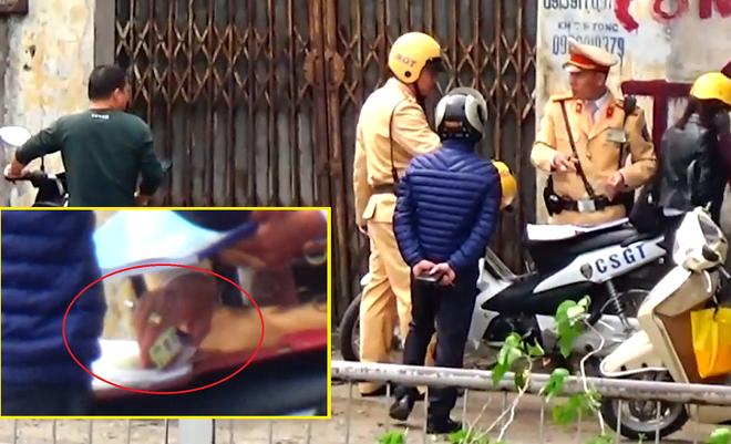 Công an Hà Nội xác nhận có cán bộ, chiến sỹ CSGT liên quan đến clip nghi mãi lộ - ảnh 1