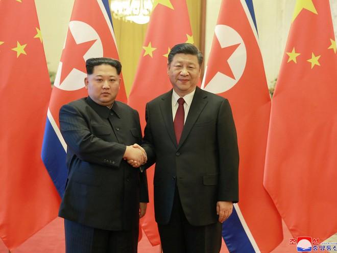 KCNA công bố loạt ảnh mãn nhãn về chuyến thăm Trung Quốc của nhà lãnh đạo Kim Jong-un - Ảnh 4.