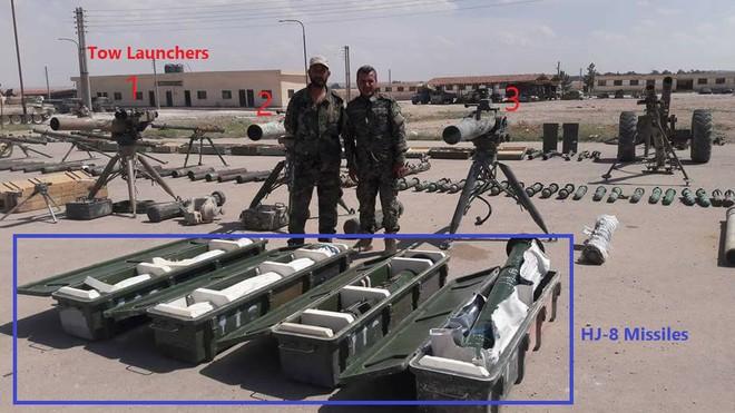 Cận cảnh số vũ khí QĐ Syria thu giữ của phiến quân ở Qalamun: Có tên lửa Mỹ, Trung Quốc - Ảnh 1.