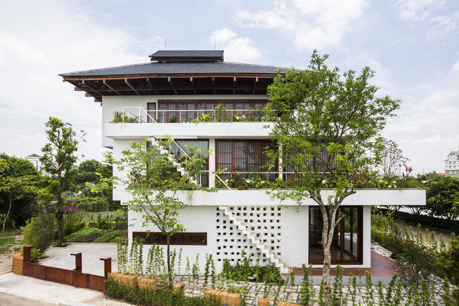 Độc đáo ngôi nhà với nhiều cửa của người Việt trên báo Mỹ - Ảnh 4.