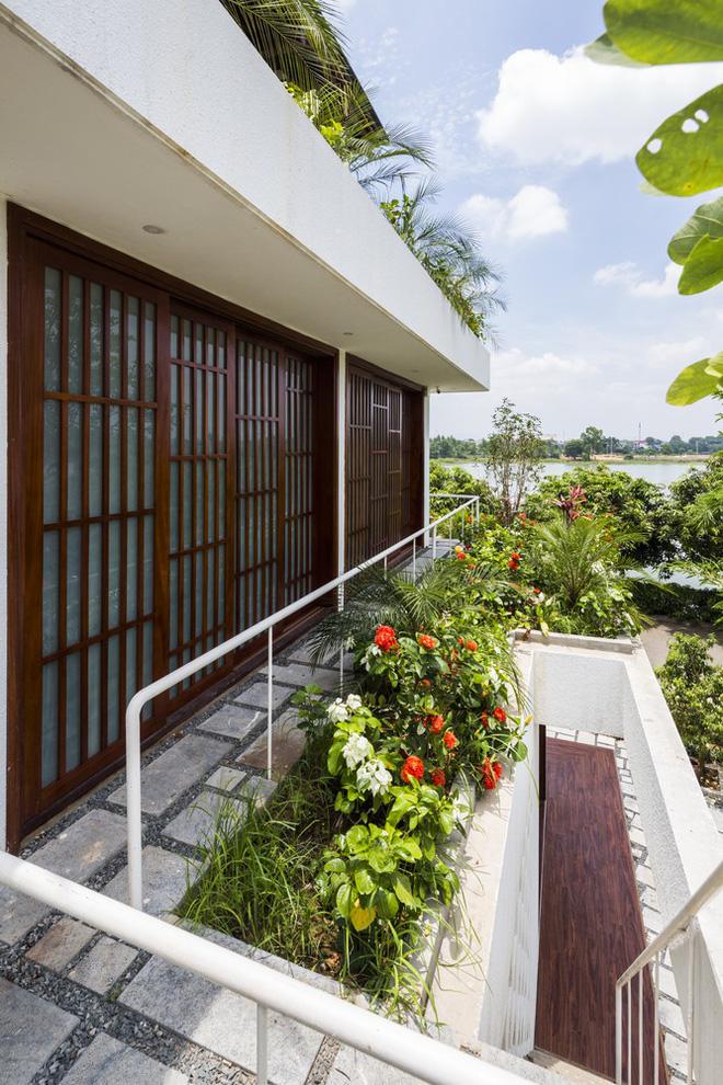 Độc đáo ngôi nhà với nhiều cửa của người Việt trên báo Mỹ - Ảnh 11.
